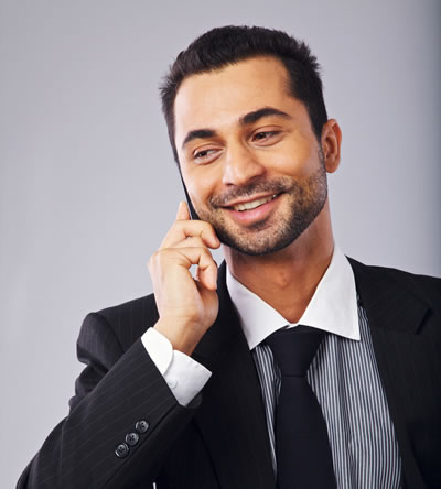 happy-young-professional-smiling-while-answering-a-phone-call_B6lQZ9L4tx
